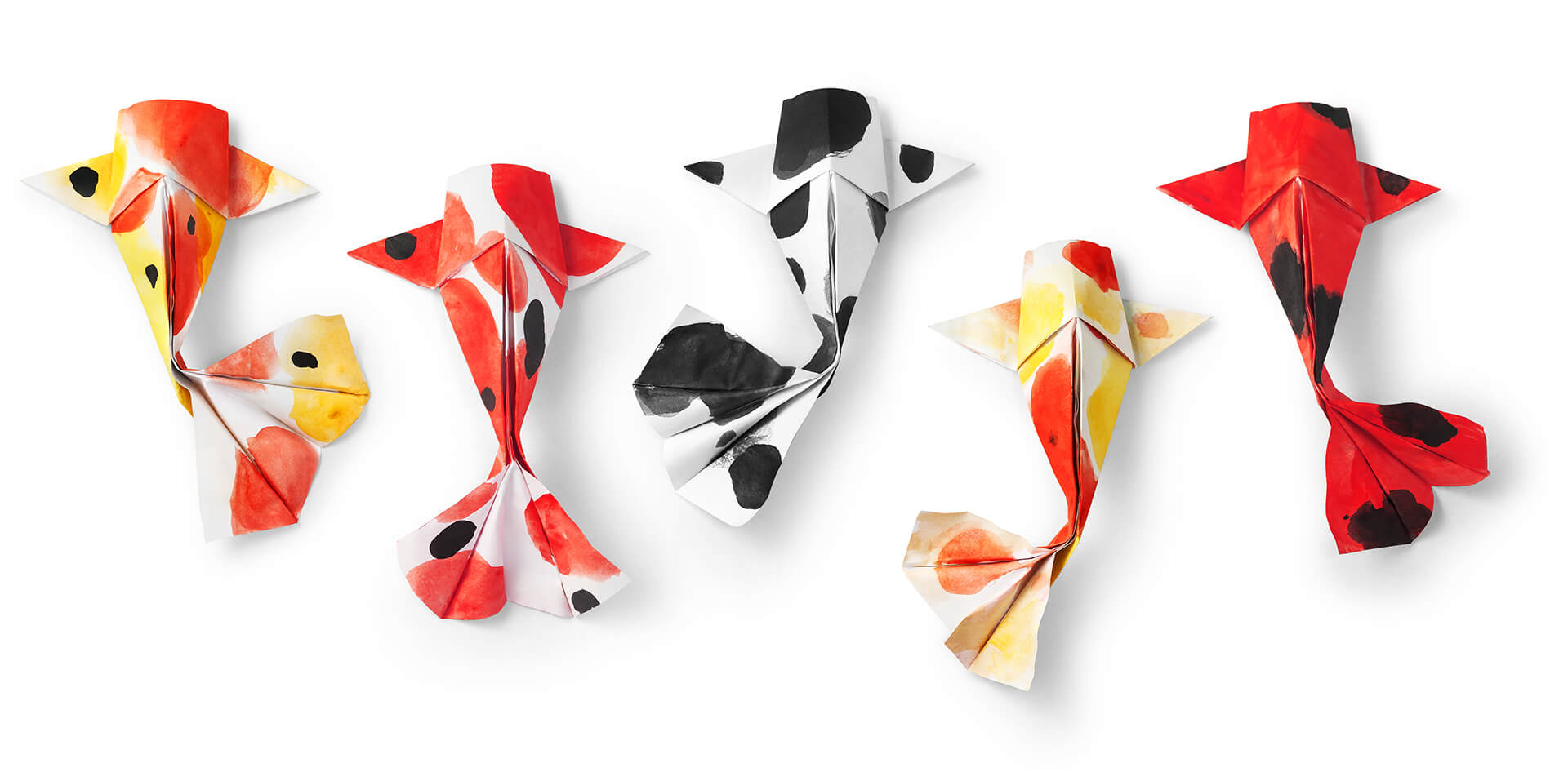 Canva_-_handmade_paper_craft_origami_koi_carp_fish_on_white_background