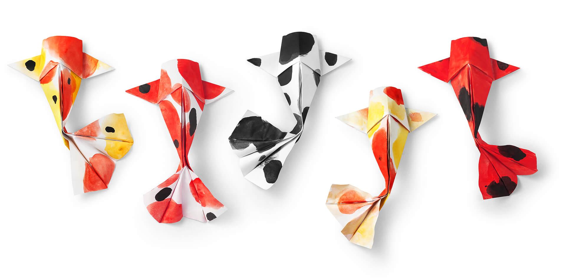 Canva_-_handmade_paper_craft_origami_koi_carp_fish_on_white_background
